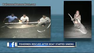 Two shark fishermen rescued from sinking boat - Video