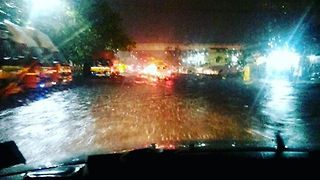 Cars Trudge Through Floodwaters in Chennai - Video
