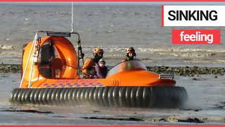 The moment boy, 7, is rescued after getting stuck in the mud on a beach - Video