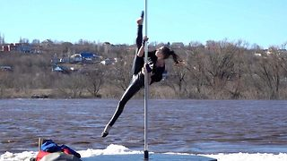 Polar dancing: Incredible acrobat performs incredible pole dancing routine while floating down river