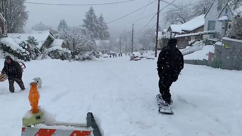 Snowboarders Shred on Olympia Streets as Winter Storms Continue