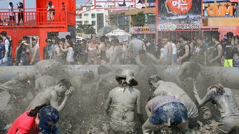 Down and dirty! Bikini-clad crowds enjoy merrymaking in the muck at South Korean mud festival