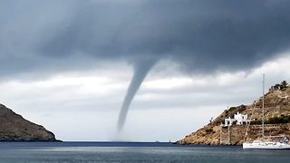 Tourists shocked as massive water tornado appears at Greek beach - Video
