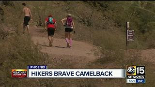 Hikers still going up Phoenix mountains in 119 heat - Video