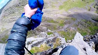 World's first ever base jump from england's highest peak captured in adrenaline-filled clip