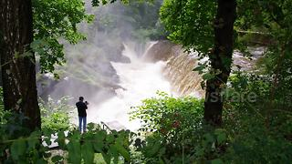 River floods, turns into massive waterfall after heavy downpour drowns Tri-state - Video