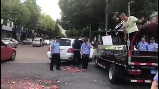 Furious fruit seller smashes watermelons to avoid punishment
