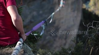 Extreme Athletes Highline Between Cliffs In Southeast France - Video