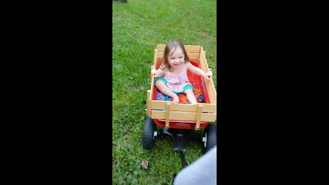 Toddler loves wagon rides