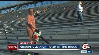 Volunteers help clean up stands at the Indianapolis Motor Speedway - Video