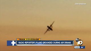Reporter flying to San Diego stranded on tarmac - Video