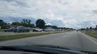 Cars queue up to depart North Carolina during Hurricane Florence evacuations