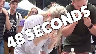 Model Destroys Sausage Eating Competition - Video