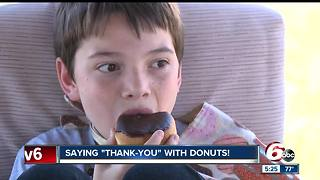 Young boy delivers donuts to police departments across the country - Video