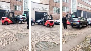 Workers Solve Parking Problem By Moving Car With A Forklift Truck   - Video