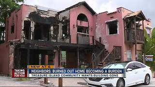 Burned-out home now burdening Treasure Island community - Video