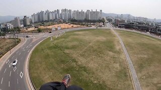 Incredible moment paraglider accidentally lands in roundabout