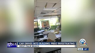 Car drives into building in West Palm Beach