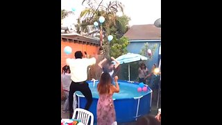 Dad Jumps Into Pool During Gender Reveal Party
