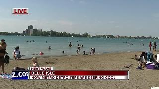 Metro Detroiters keeping cool on a hot Monday