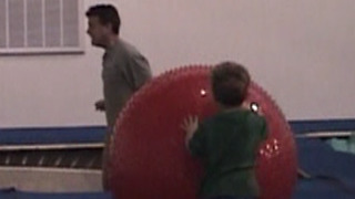 Son Trips Father On Trampoline - Video