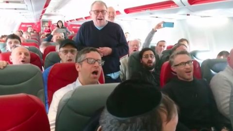Incredible moment choir break into song mid-flight