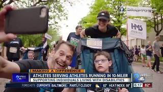 Local group pushing runners with disabilities in Baltimore 10-miler - Video