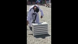 Bosnian teenager smashes blocks with head to break record - Video