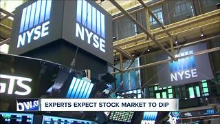 Stocks climb, experts warn