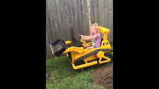 Little Girl Helps Dad Out Using Her Mini Bulldozer