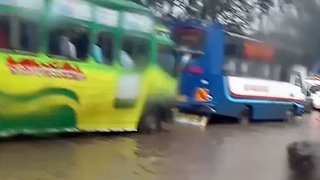 Cars Move Through Flooded Streets During Rush Hour Flooding in Nairobi - Video