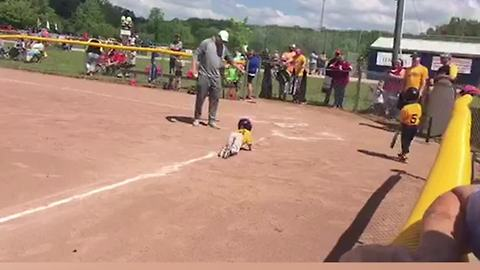 Little Boy Crawls Into Home Plate in T-ball
