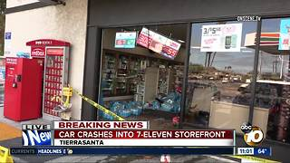 Car crashes into 7-Eleven - Video