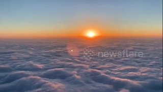 Gorgeous time-lapse shows sunrise over clouds roiling like waves - Video