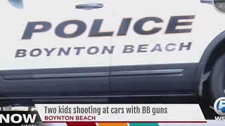 Two kids shooting at cars with BB guns - Video