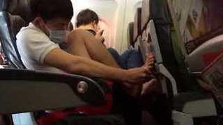 Woman Disgusted as AirAsia Passenger Picks at Feet and Toenails on Flight - Video