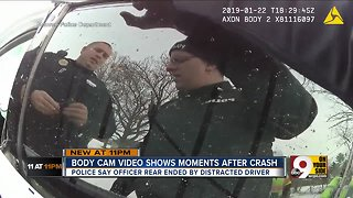 Body camera video shows moments after truck hit police car