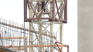 Crews rescue crane operator during medial emergency - Video