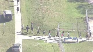 Video shows teenagers running from Florida school - Video