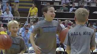 Young Boy Sinks Three Half-Court Shots in a Row During Halftime Show - Video