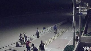 CCTV captures horrifying moment man knocks down two party goers - Video