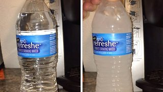 Incredible moment bottled water instantly freezes when banged against table