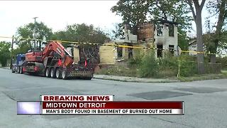 Man's body found in basement of burned out home - Video