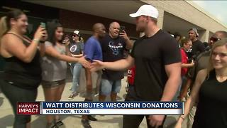 J.J. Watt distributes Hurricane Harvey Donations - Video