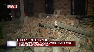 Car slams into house on Detroit's west side. children injured - Video