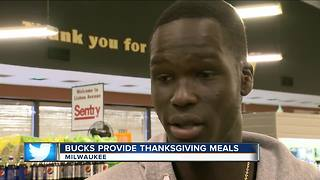 Bucks player hands out Thanksgiving meals to local families - Video