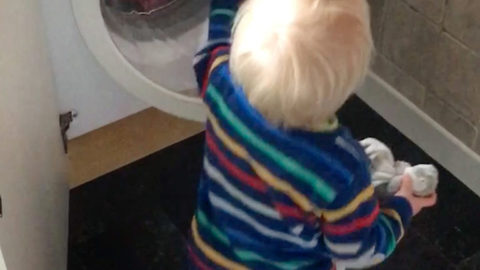 Adorable moment boy can't close washing machine door