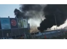 Emergency Services Evacuate Shopping Centre After Light Plane Crashes Into Building - Video