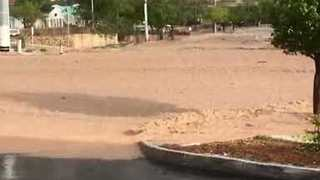 Flash Floods Turn Road Into River in Mesa Hills