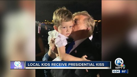 Local kids receive presidential kiss